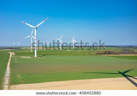 Aerial view on the windmills on the field