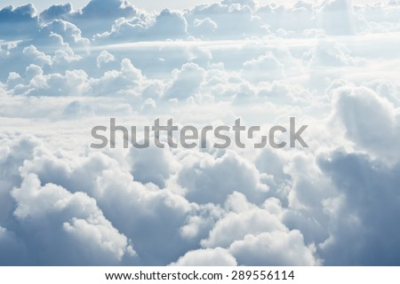 Aerial view on white fluffy clouds - stock photo