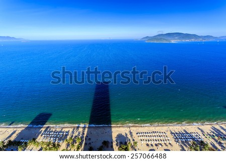 Aerial view over beach Nha Trang city, Vietnam taken from rooftop - stock photo