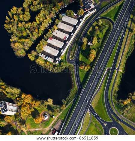aerial view over buildings and highway - stock photo