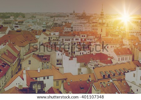 Aerial view over Church of Our Lady before Tyn, Old Town and Prague Castle at sunset in Prague, Czech Republic. Vintage effect. - stock photo