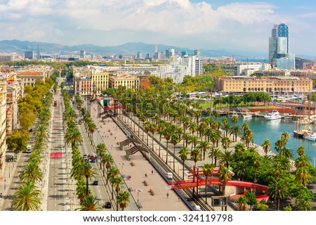 Aerial view over Passeig de Colom or Columbus avenue,  La Barceloneta and Port Vell marina  from Christopher Columbus monument  in Barcelona, Catalonia, Spain - stock photo