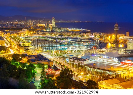 Aerial view over Port Vell marina, Passeig de Colom, Barceloneta and Rambla de Mar at night in Barcelona, Catalonia, Spain - stock photo