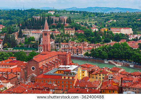Aerial view over Santa Anastasia Church and red roofs  in cloudy summer day, Verona, Italy - stock photo