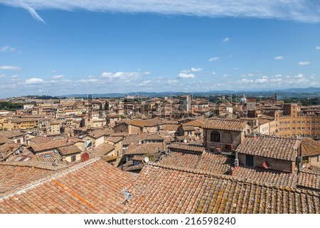 Aerial view over Sienna (city in Tuscany) in Italy, Europe - stock photo