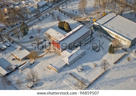 aerial view over snowy small town - stock photo