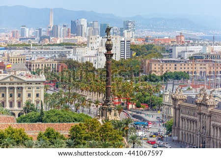 Aerial view over square Portal de la pau, and Port Vell marina and Columbus Monument in Barcelona, Catalonia, Spain