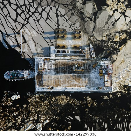 Aerial view over the barge at the platform in the port - stock photo