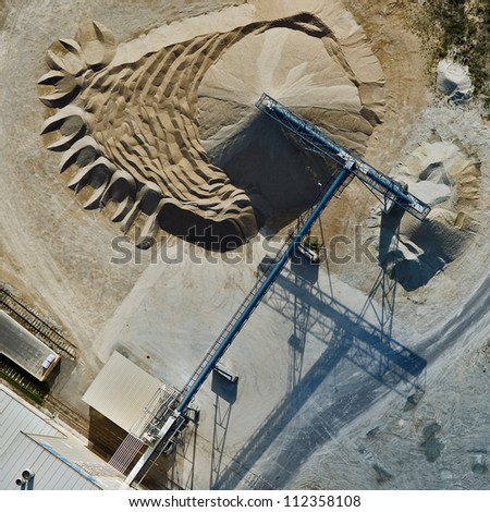 aerial view over the building materials processing factory - stock photo