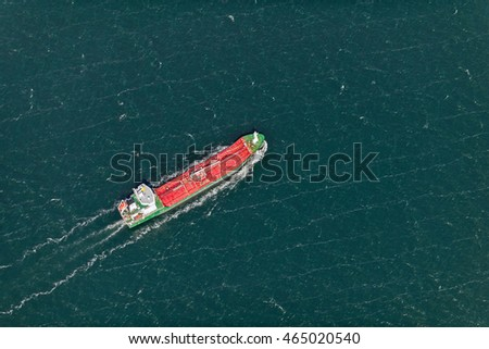 aerial view over the commercial ship in the sea