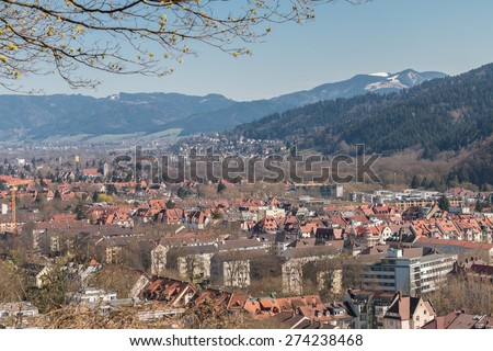 Aerial view over the eastern part of Freiburg, a famous medieval city at the edge of the Black Forest, Germany - stock photo