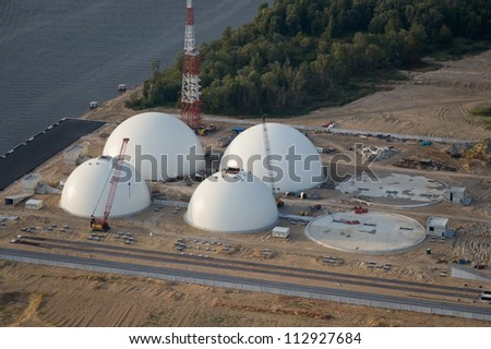 Aerial view over the fertilizer's terminal under construction - stock photo
