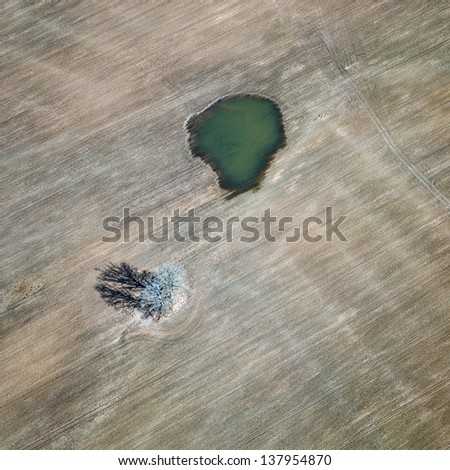 aerial view over the field in springtime - stock photo