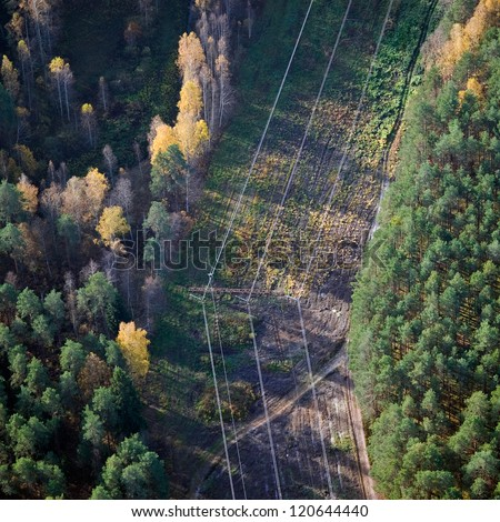 Aerial view over the high voltage power line - stock photo