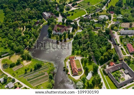 aerial view over the manor at the pool - stock photo
