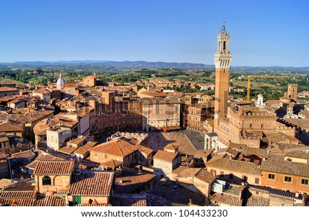 Aerial view over the medieval city of Siena, Italy including Il Campo - stock photo