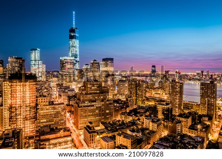 Aerial view over the New York Financial District at dusk. - stock photo