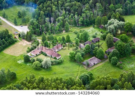 aerial view over the old cottage - stock photo