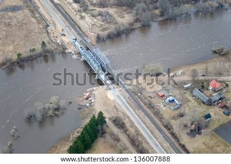 Aerial view over the overflooded river in springtime