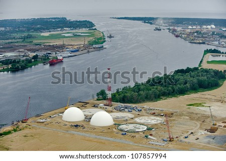 aerial view over the Riga industrial port - stock photo