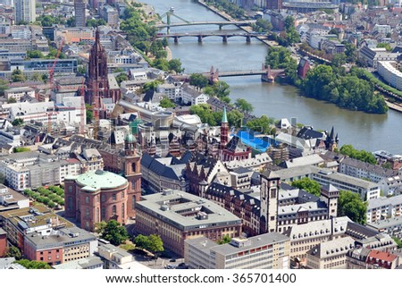 Aerial view over the river Main from the Main Tower in Frankfurt am Main in Germany. - stock photo