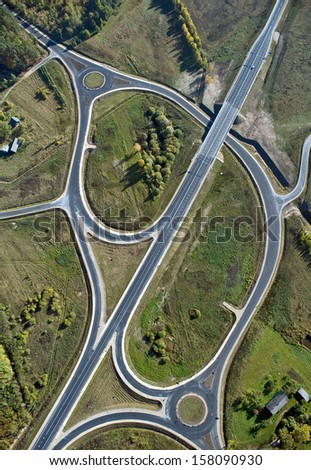 aerial view over the road intersection - stock photo