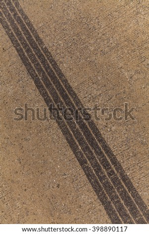 Aerial view over the road, Tire tracks on road
