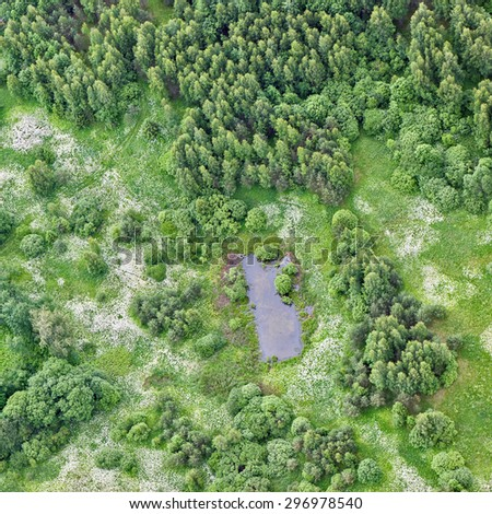 aerial view over the rural field - stock photo