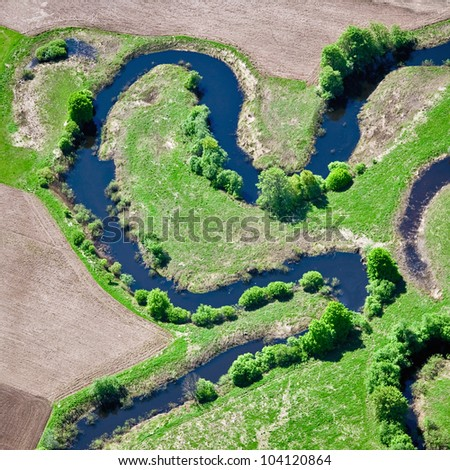 aerial view over the small river - stock photo