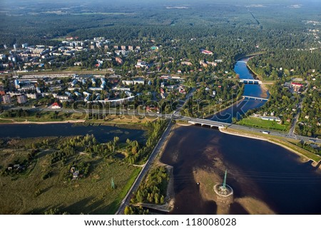 Aerial view over the town at the river - stock photo