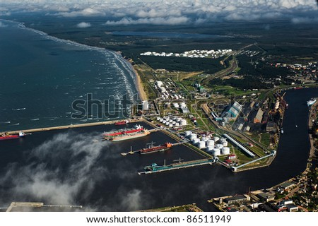 aerial view over Ventspils industrial port - stock photo