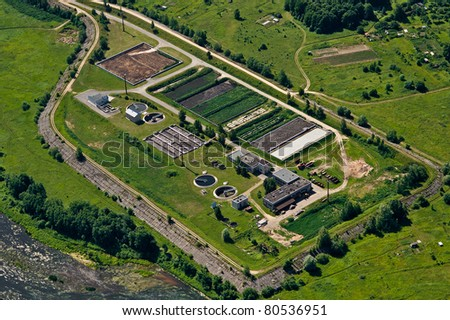Aerial view over water purification bassins - stock photo