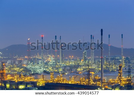 Aerial view petrochemical factory at twilight with mountain background