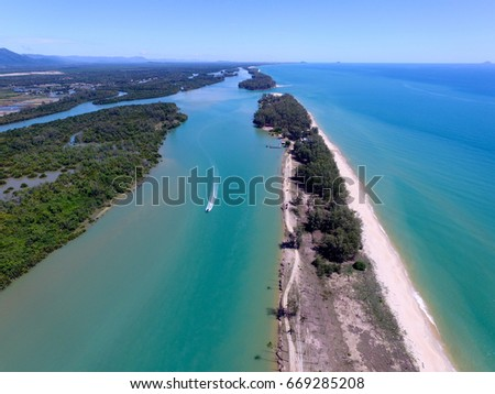 aerial view river estuary and small boat