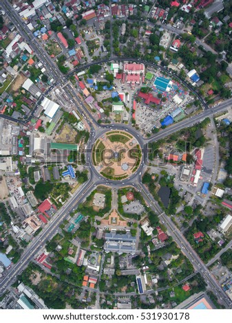Aerial view Road roundabout with car lots in the city in Thailand.street large beautiful downtown .cityscape.