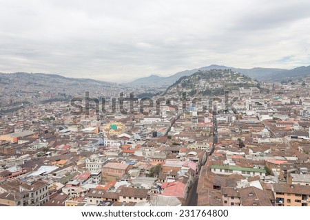 aerial view rooftops in old town Panecillo hill Quito Ecuador South America - stock photo