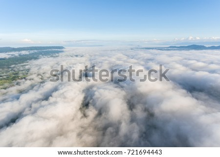 Aerial view,sea fog covers the mountain