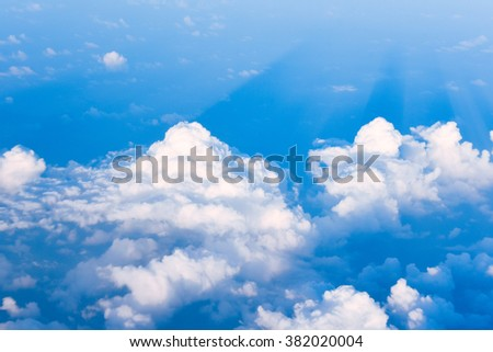 aerial view sunset shadow soft clouds blue sky