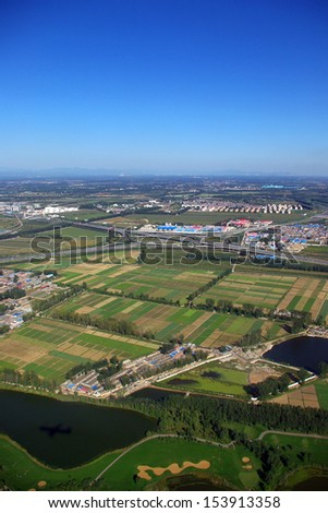 Aerial view that can see rice field terraces, city and highway, china - stock photo