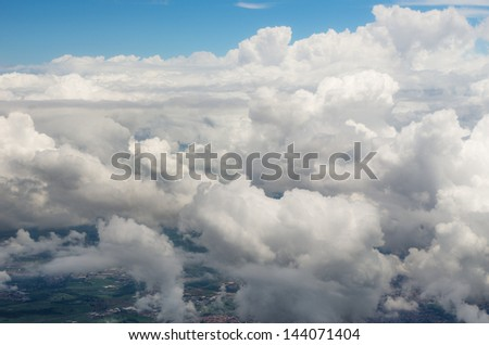 aerial view through lot of clouds - stock photo