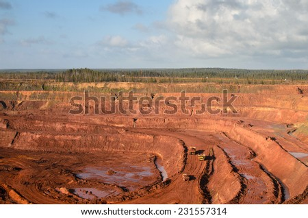 Aerial view to an open mine - stock photo