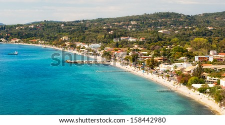 Aerial view to beach under sunlight at Ipsos village, Corfu, Greece
