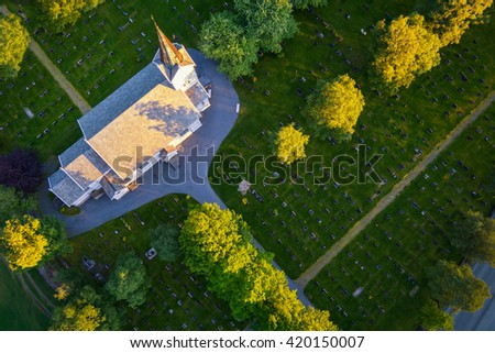 Aerial view to churchyard - cemetery in Norway at sunset