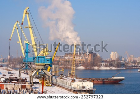 Aerial view to empty cargo dock with cranes and containers
