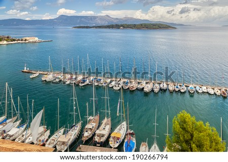 Aerial view to pier with yachts and boats from venetian old fortress, Kerkyra, Corfu, Greece. - stock photo