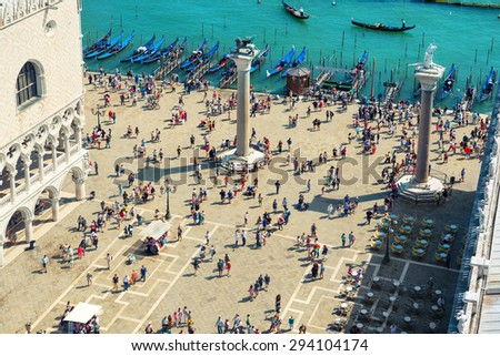 Aerial view to San Marcus Square from bell tower. Crowd of people walking in Venice city. - stock photo
