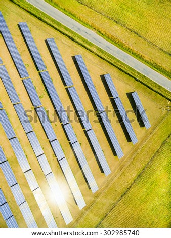 Aerial view to solar power plant. Industrial background on renewable resources theme. - stock photo