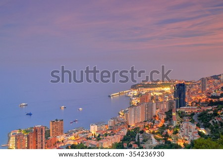 Aerial view to the buildings and harbor of Monte Carlo at dusk, Monaco, French Riviera - stock photo