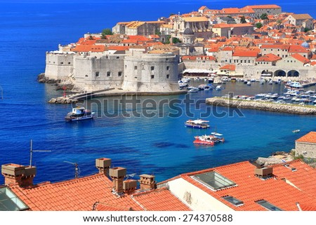 Aerial view to the Eastern harbor surrounded by fortified walls of the Dubrovnik old town, Croatia - stock photo