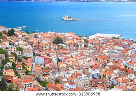 Aerial view to the old town of Nafplio and distant islet of Bourtzi, Greece - stock photo